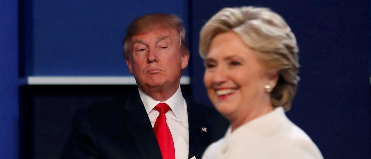 Donald Trump and Hillary Clinton finish their third and final 2016 presidential campaign debate. (Credit: REUTERS/Mike Blake)