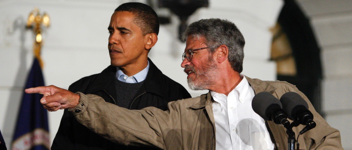 U.S. President Barack Obama gets direction from White House science adviser John Holdren during an event to look at the stars with local middle school students and astronomers from across the country on the South Lawn at the White House in Washington, October 7, 2009. REUTERS/Jim Young