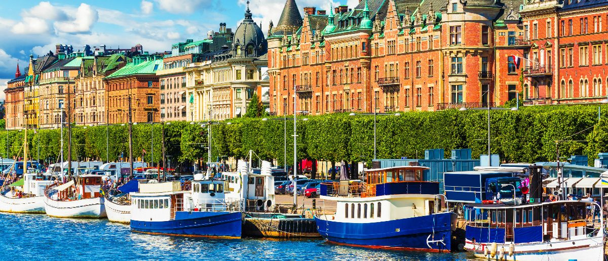 Scenic summer panorama of the Old Town (Gamla Stan) pier architecture in Stockholm, Sweden: Scanrail1/shutterstock
