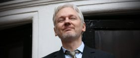 Wikileaks founder Julian Assange squints in the sunlight as he prepares to speak from the balcony of the Ecuadorian embassy where he continues to seek asylum following an extradition request from Sweden in 2012, on February 5, 2016 in London, England. The United Nations Working Group on Arbitrary Detention has insisted that Mr Assange's detention should be brought to an end. Carl Court/Getty Images.