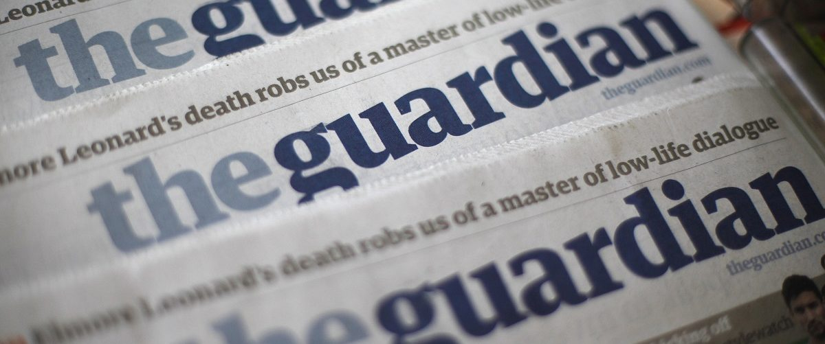 Copies of the Guardian newspaper are displayed at a news agent in London August 21, 2013. British Prime Minister David Cameron ordered his top civil servant to try to stop revelations flowing from the Guardian newspaper about U.S. and British surveillance programmes, two sources with direct knowledge of the matter said. REUTERS/Suzanne Plunkett.