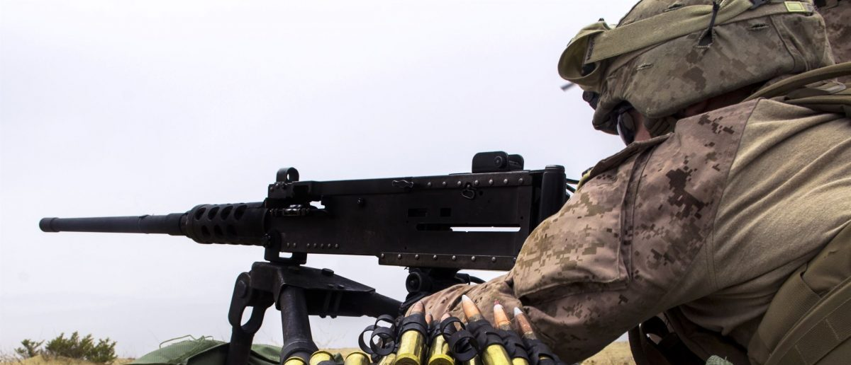 A U.S. Marine fires an M2 .50 caliber machine gun as part of a live-fire exercise during Eagle Resolve 2013 at a range on Camp Al-Galail, Qatar, April 27, 2013.  Source: U.S. Department of Defense