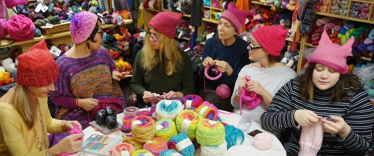 A group of women gather at Knitty City in New York on January 17, 2017 to make their pink Pussyhats in preparation for protests, in Washington and New York, for women's rights following the election of Donald Trump. William Edwards/AFP/Getty Images.