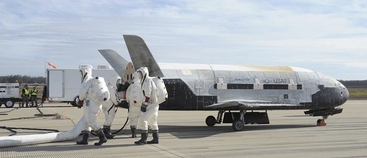 The X-37B Orbital Test Vehicle mission 3 space plane is shown after landing at Vandenberg Air Force Base, California October 17, 2014 in this handout photograph provided by Vandenberg Air Force Base. The United States military landed the robotic space plane in central California on Friday, ending a classified 22-month mission that marked the third in Earth orbit for the experimental program, the Air Force said. (REUTERS/Boeing/Vandenberg Air Force Base/Handout via Reuters)