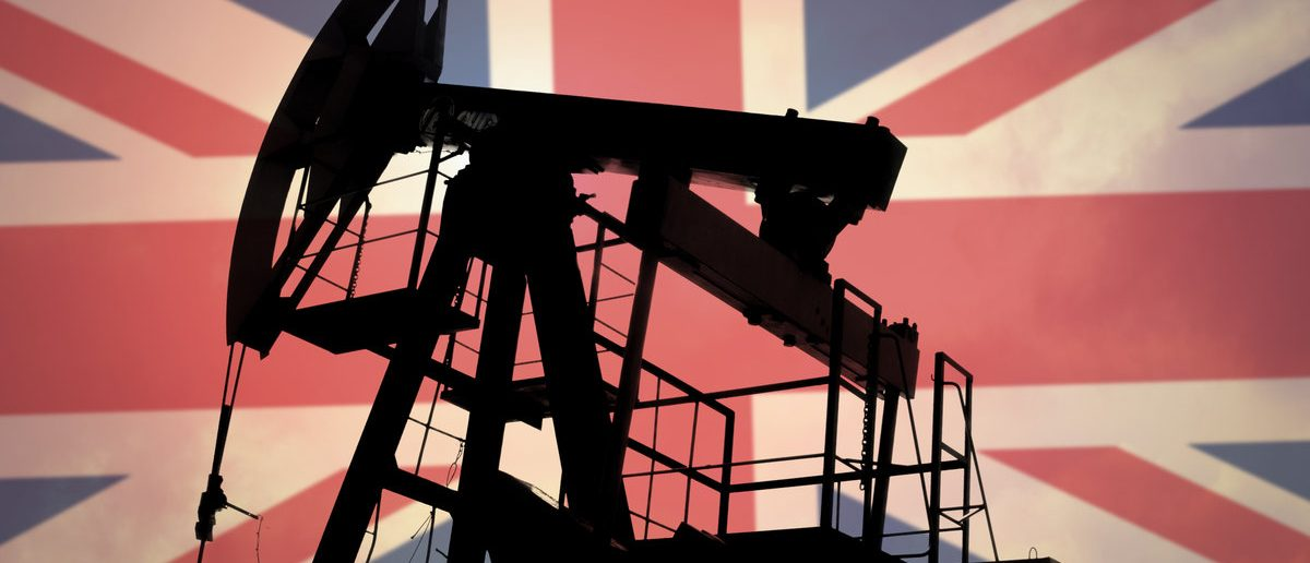 Oil pump on background of flag of United Kingdom (Shutterstock.com/Anton Watman)