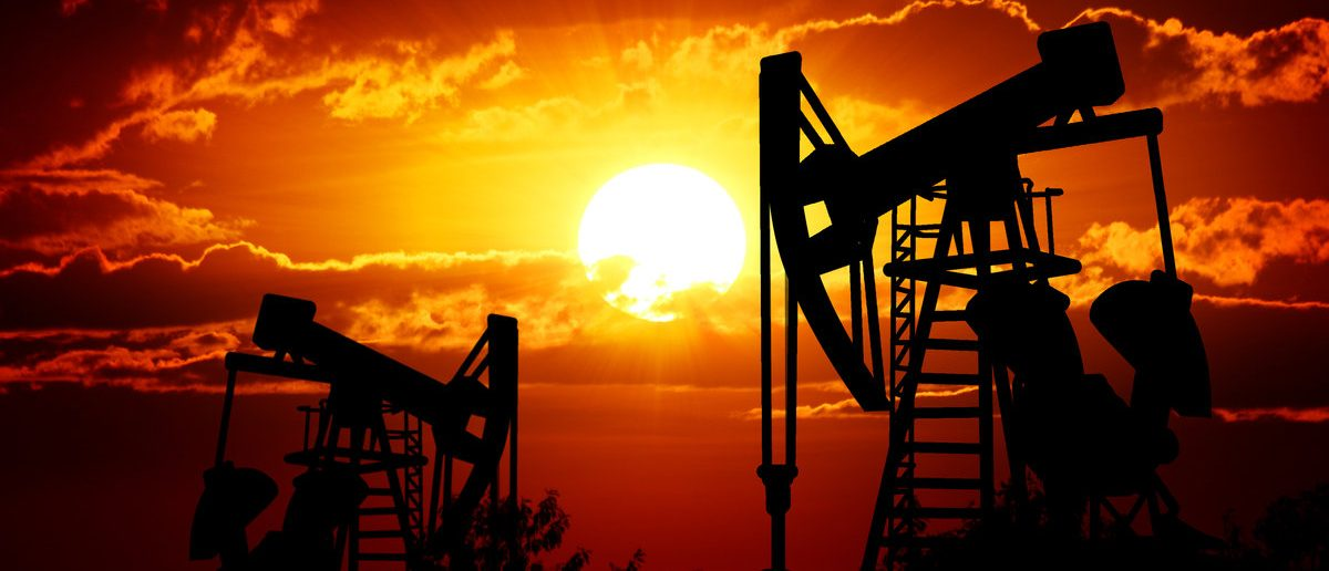 Sunset sky with profiled oil well (Shutterstock/artphotoclub)