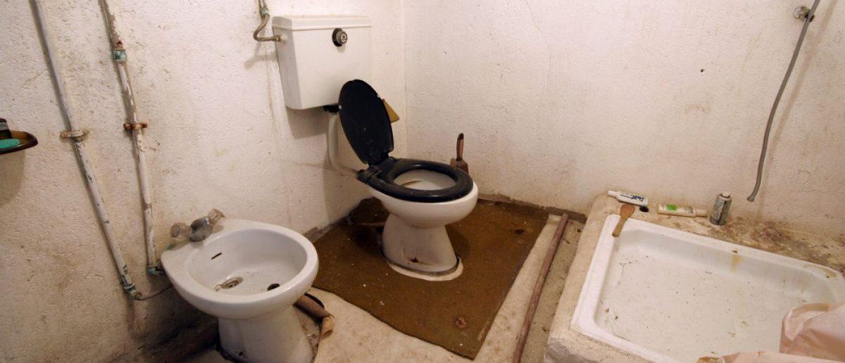 A dilapidated bathroom. [Shutterstock - Jorge Casais]
