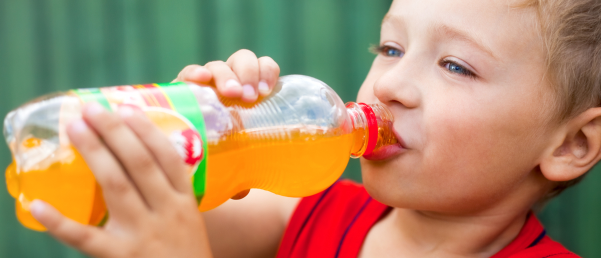 A little boy drinks some deliciously unhealthy soda. (Photo: Shutterstock/Dundanim)