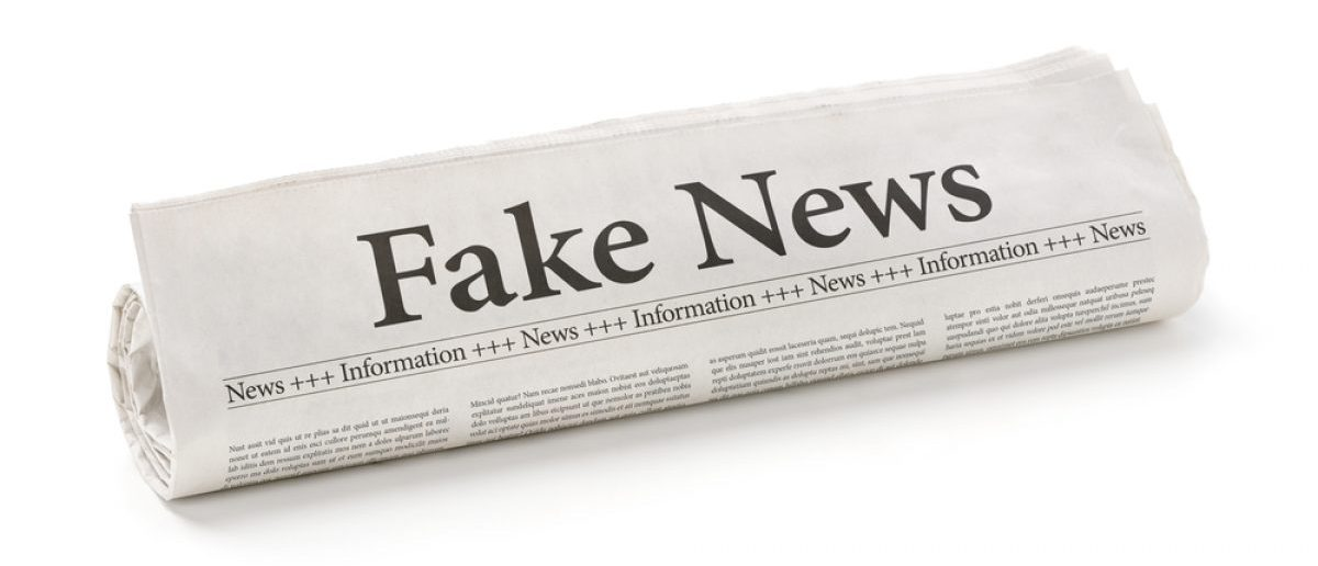 "Mainstream newspaper showing ""fake news."" [Shutterstock - 556324534]"
