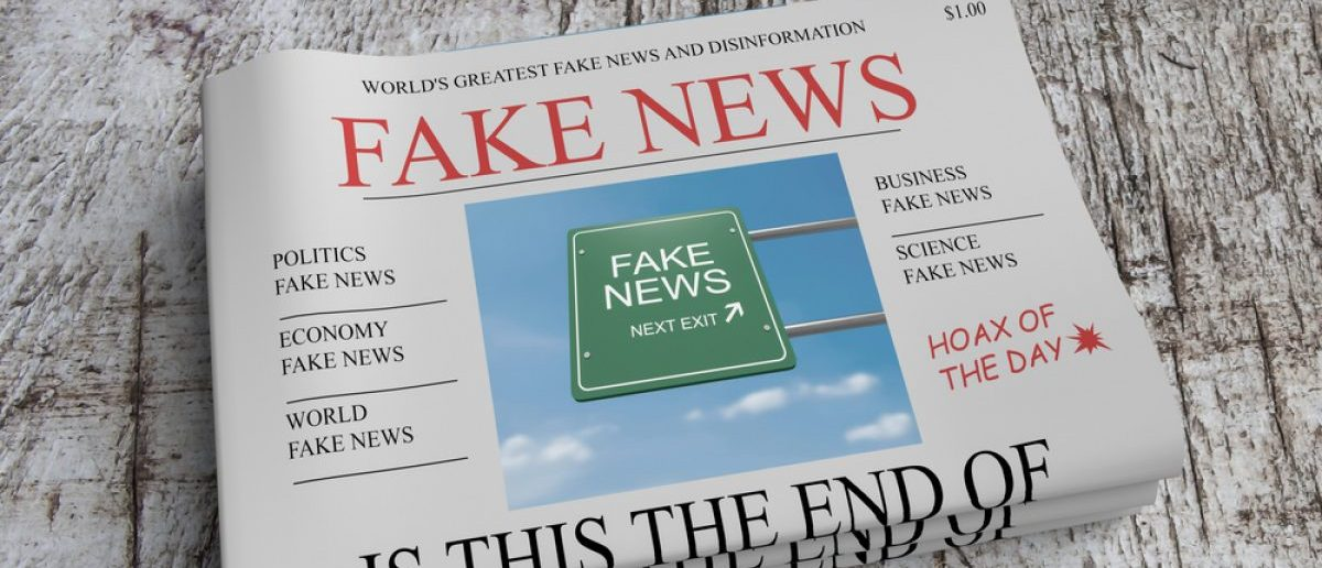 Pile of newspapers with fake news. (Credit: cbies/Shutterstock)