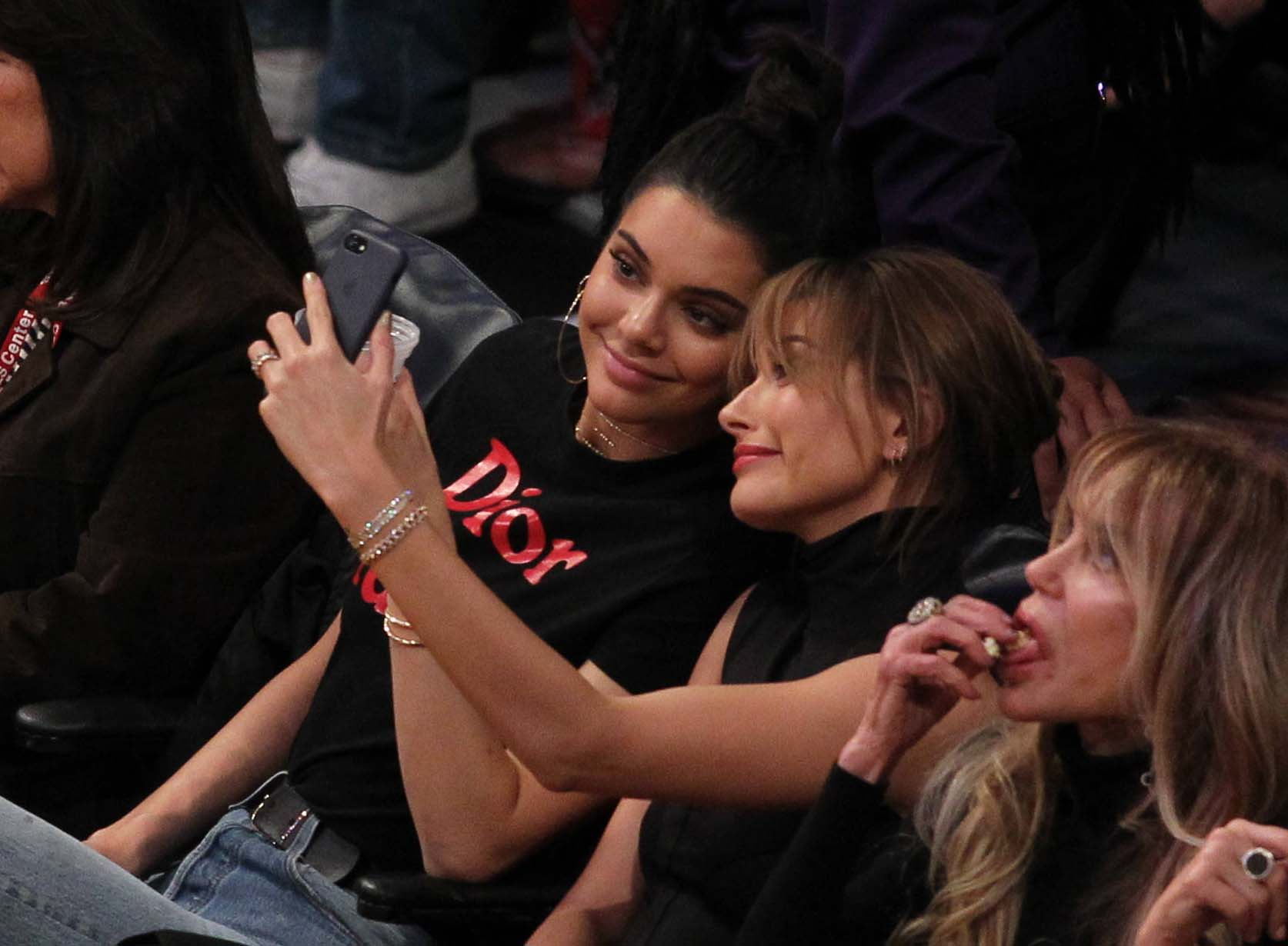 Kendall Jenner spotted at the Lakers game with Hailey Baldwin (Photo credit: Splash News)