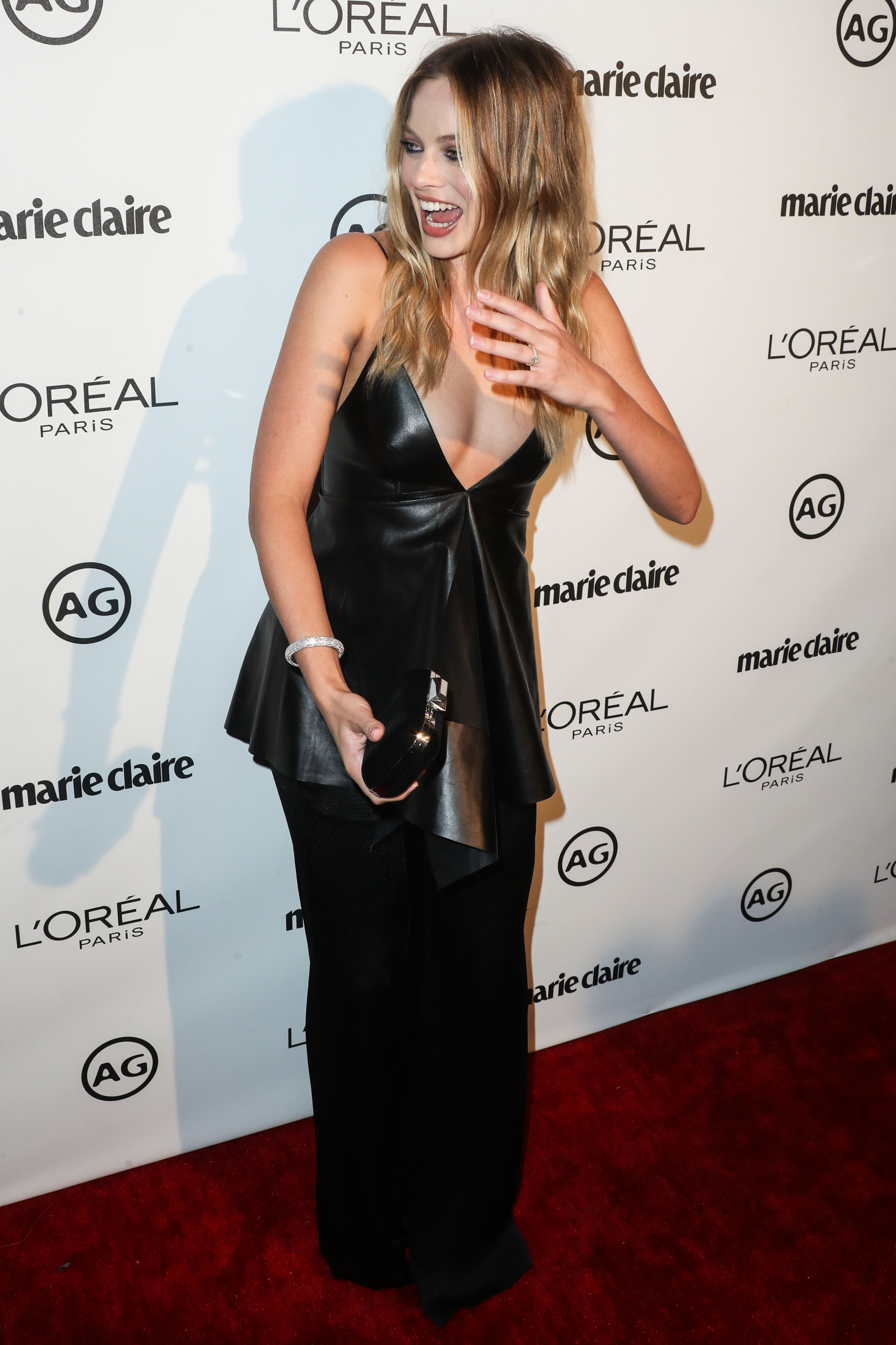 Actress Margot Robbie shows off her wedding ring from Tom Ackerley at Marie Claire's Image Maker Awards 2017 (Photo credit: Splash News)