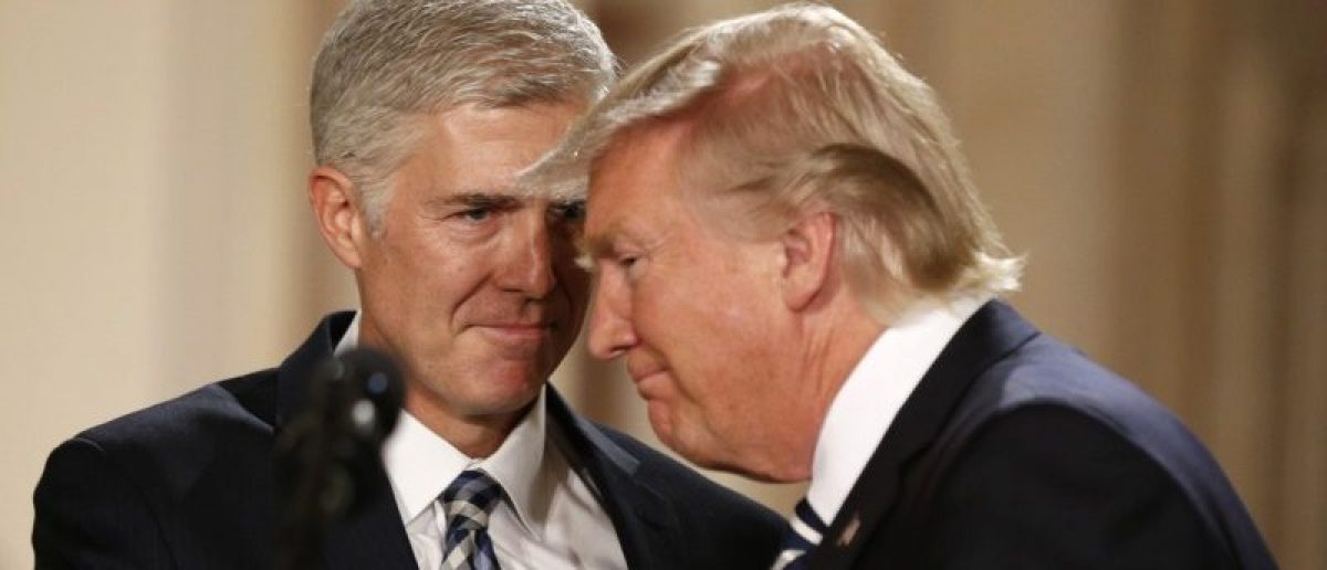 President Trump and Neil Gorsuch smile as Trump nominated Gorsuch to be an associate justice of the Supreme Court at the White House. REUTERS/Kevin Lamarque