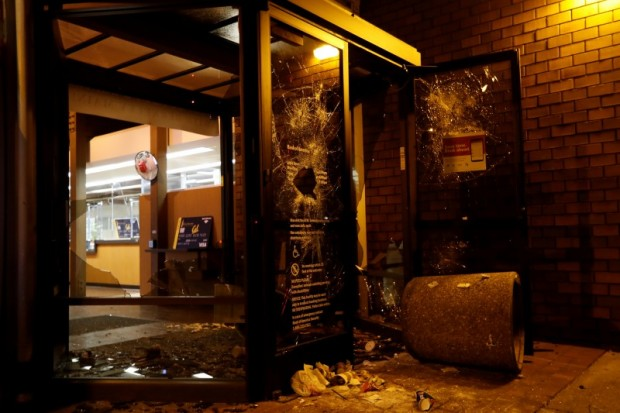 A vandalized Bank of America office is seen after a student protest turned violent at UC Berkeley during a demonstration over right-wing speaker Milo Yiannopoulos in Berkeley (REUTERS)