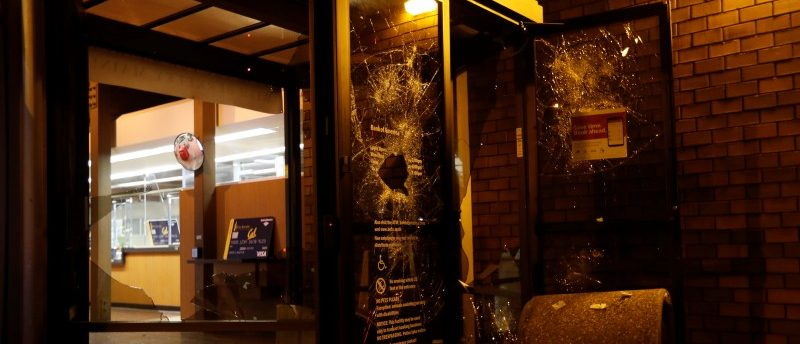 A vandalized Bank of America at UC Berkeley during a demonstration over right-wing speaker Milo Yiannopoulos. (REUTERS)