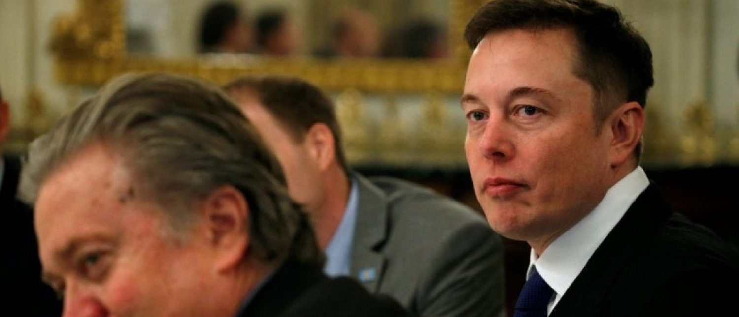 Tesla CEO Elon Musk (R) sits beside Senior Counselor to the President Steve Bannon (L) as U.S. President Donald Trump hosts a strategy and policy forum with chief executives of major U.S. companies at the White House in Washington February 3, 2017. REUTERS/Kevin Lamarque | Musk Goes All In On Trump's Tariffs