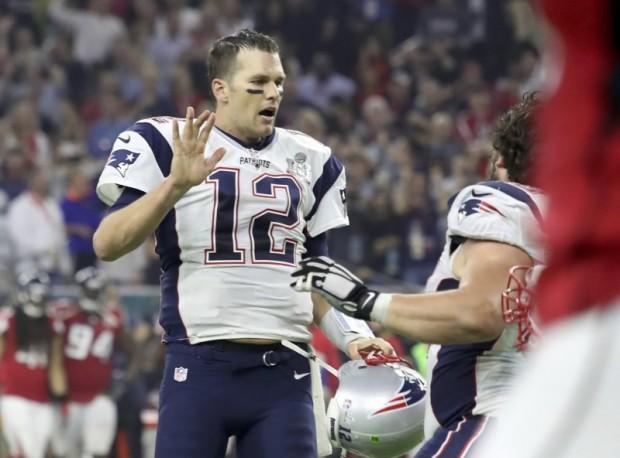 New England Patriots' quarterback Tom Brady celebrates his team's game-winning touchdown against the Atlanta Falcons at Super Bowl LI in Houston, Texas, U.S., February 5, 2017. REUTERS/Adrees Latif