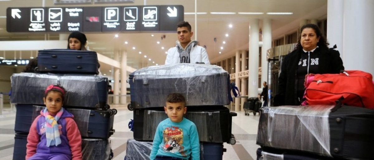The al-Qassab family, Iraqi Christian refugees from Mosul, pose with their luggage at Beirut international airport ahead of their travel to the United States, Lebanon February 8, 2017. REUTERS/Mohamed Azakir