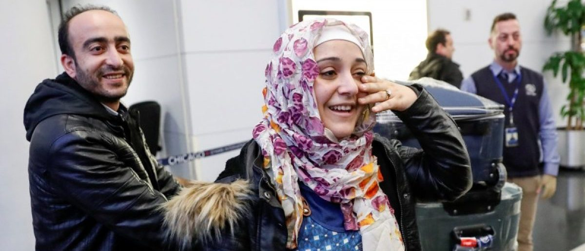 Syrian refugees Baraa and her husband Abdulmajeed Haj Khalaf smile after arriving at O'Hare International Airport in Chicago, Illinois, U.S. February 7, 2017. REUTERS/Kamil Krzaczynski