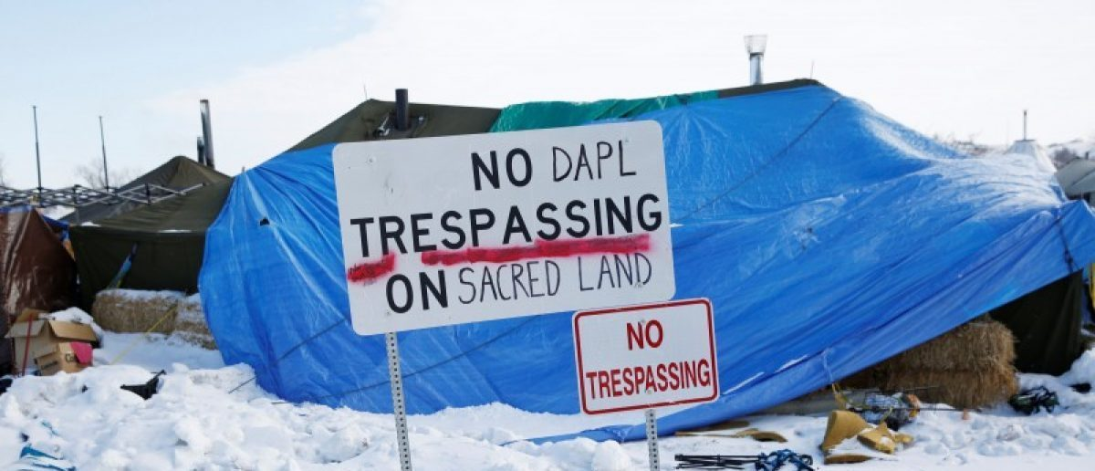 "A modified ""No Trespassing"" sign is seen in the opposition camp against the Dakota Access oil pipeline (DAPL) near Cannon Ball, North Dakota, U.S., February 8, 2017. REUTERS/Terray Sylvester"