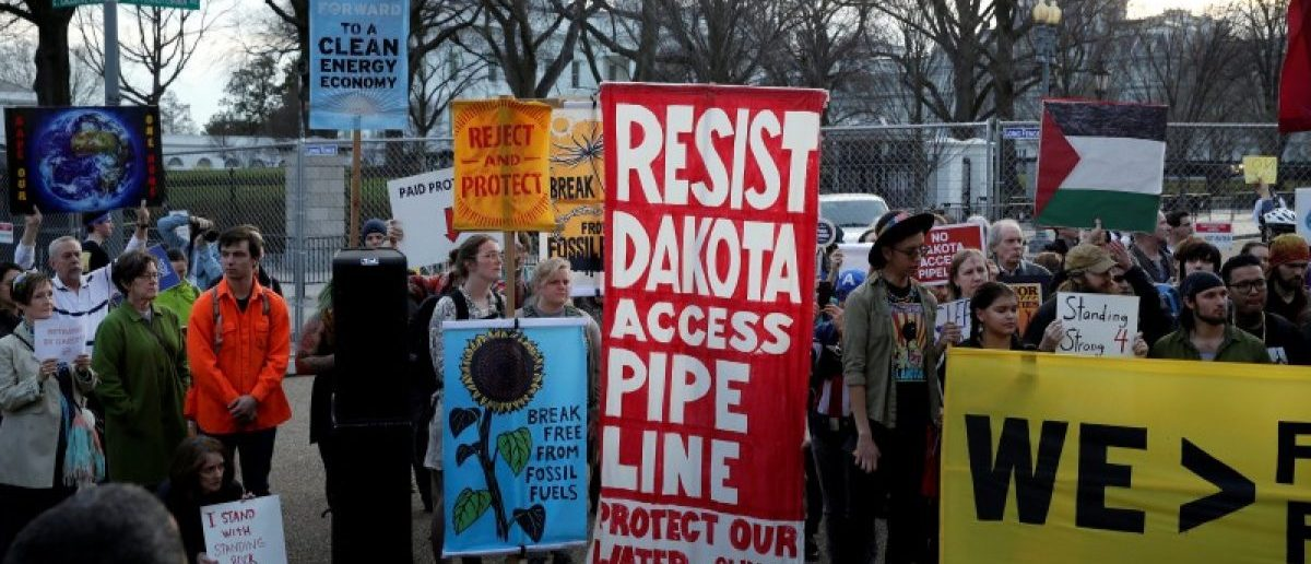People protest against U.S. President Donald Trump's directive to permit the Dakota Access Pipeline during a demonstration at the White House in Washington.