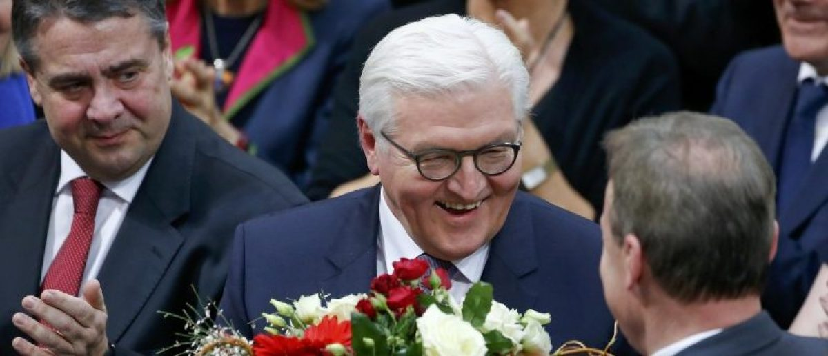 German president-elect, Frank-Walter Steinmeier, receives flowers after the first round of voting of the German presidential election at the Reichstag in Berlin, February 12, 2017. REUTERS/Hannibal Hanschke