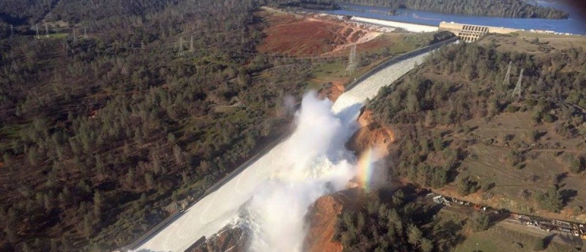 A damaged spillway with eroded hillside is seen in an aerial photo taken over the Oroville Dam in Oroville, California. California Department of Water Resources/William Croyle/Handout via REUTERS