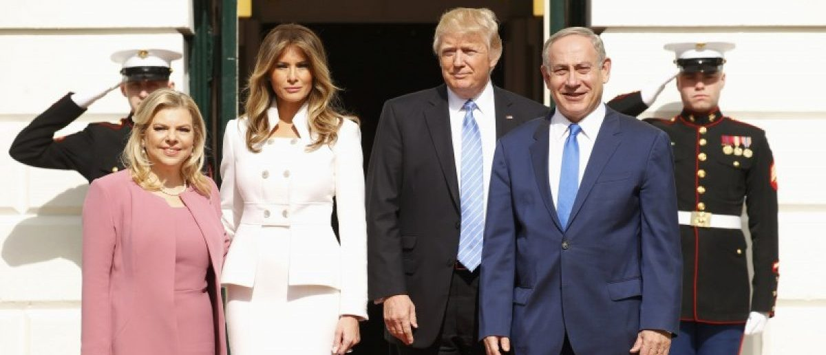 U.S. President Donald Trump (2ndR) and first lady Melania Trump greet Israeli Prime Minister Benjamin Netanyahu and his wife Sara (L) as they arrive at the South Portico of the White House in Washington, U.S., February 15, 2017. REUTERS/Kevin Lamarque