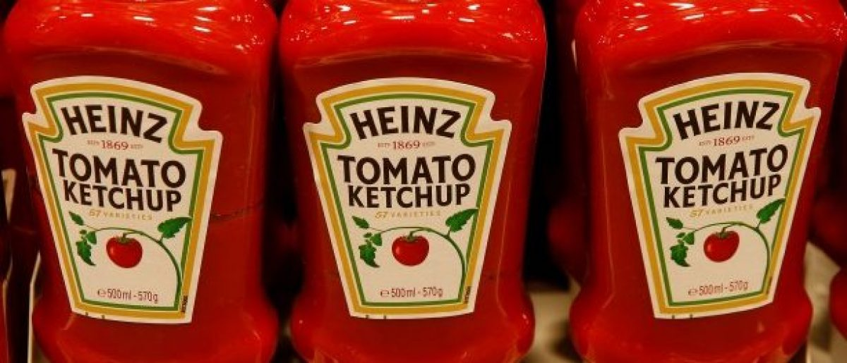 FILE PHOTO - Bottles of Heinz tomato ketchup of U.S. food company Kraft Heinz are offered at a supermarket in Zumikon, Switzerland December 13, 2016. REUTERS/Arnd Wiegmann/File Photo
