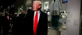 U.S. President Donald Trump pauses at the Dr. Ben Carson exhibit at the National Museum of African American History and Culture in Washington, U.S., February 21, 2017. REUTERS/Jonathan Ernst