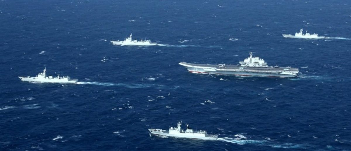 FILE PHOTO: China's Liaoning aircraft carrier with accompanying fleet conducts a drill in an area of South China Sea in this undated photo taken December, 2016. REUTERS/Stringer/File Photo