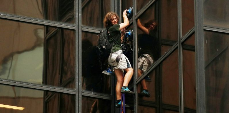 FILE PHOTO -- A man climbs the outside of Trump Tower in New York, U.S., August 10, 2016. REUTERS/Lucas Jackson/File Photo