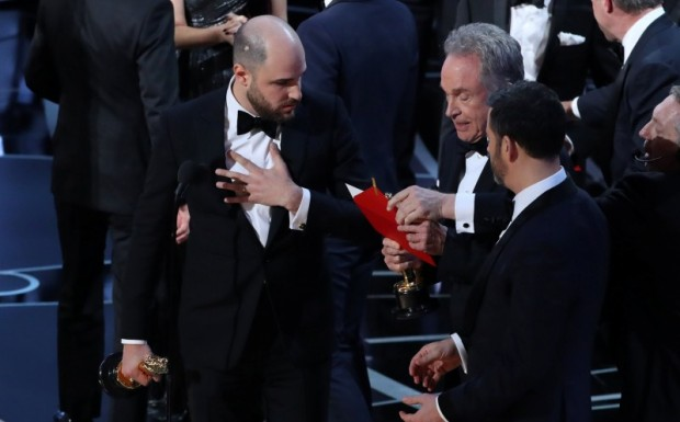 "89th Academy Awards - Oscars Awards Show - Hollywood, California, U.S. - 26/02/17 - Jordan Horowitz and Jimmy Kimmel react as Warren Beatty holds the card for the Best Picture Oscar awarded to ""Moonlight,"" after announcing by mistake that ""La La Land"" was winner. REUTERS/Lucy Nicholson"