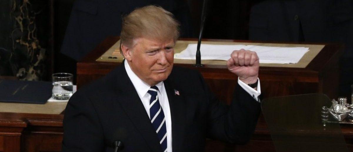 U.S. President Trump Addresses Joint Session of Congress - Washington, U.S. - 28/02/17 - U.S. President Donald Trump pumps his fist as he arrives at the podium. REUTERS/Jonathan Ernst