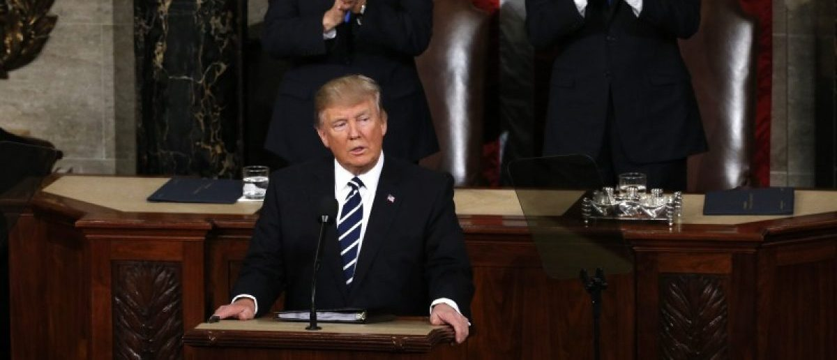 U.S. President Trump Addresses Joint Session of Congress - Washington, U.S. - 28/02/17 - U.S. President Donald Trump speaks as Vice President Mike Pence (L) and Speaker of the House Paul Ryan applaud. REUTERS/Jonathan Ernst