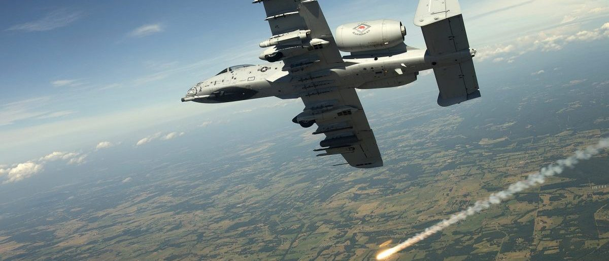 Lt. Col. Brian Burger fires off a flare while banking into a high-angle firing position during a training exercise over Razorback Range at Fort Chaffee Maneuver Training Center, Ark., June 4, 2012. The 188th Fighter Wing, nearing its second deployment to Afghanistan with the A-10 Thunderbolt II, regularly conducts training with joint terminal attack controllers from different branches of service to sharpen its close air support skills and to conduct efficient training with JTACs. Burger is an A-10 pilot and the 188th Operations Group commander. (U.S. Air Force photo by Master Sgt. Ben Bloker)