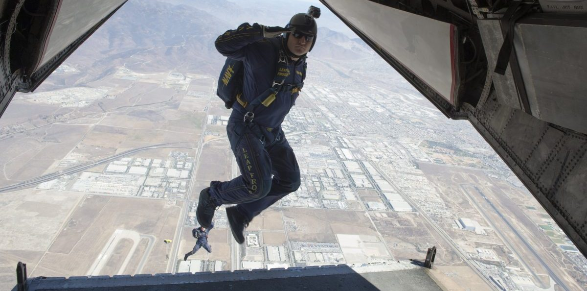 SAN DIEGO (Sept. 25, 2013) Chief Special Warfare Operator (SEAL) Brad Woodard, assigned to the U.S. Navy parachute demonstration team, the Leap Frogs, jumps from a C-2A Greyhound aircraft from the Providers of Fleet Logistics Support Squadron (VRC) 30 during parachute jump training. The Leap Frogs are based in San Diego and perform aerial parachute demonstrations around the nation in support of Naval Special Warfare and Navy Recruiting. (U.S. Navy photo by Mass Communication Specialist 3rd Class Jasmine Sheard/Released) 130925-N-SH505-054