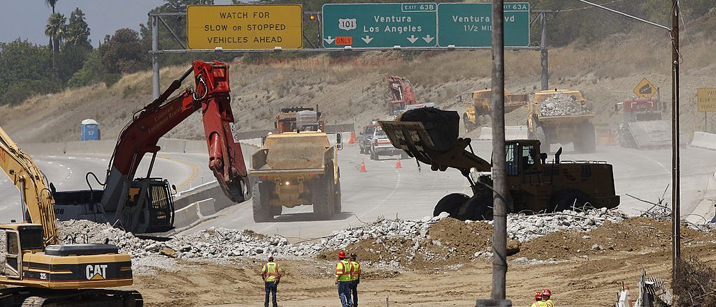 "Workers demolish the south side of Mulholland overpass on the 405 freeway during the 53-hour total freeway closure dubbed ""Carmageddon"" for the resulting massive traffic disruptions expected throughout the region, on July 16, 2011 in Los Angeles.  (Photo by David McNew/Getty Images)"