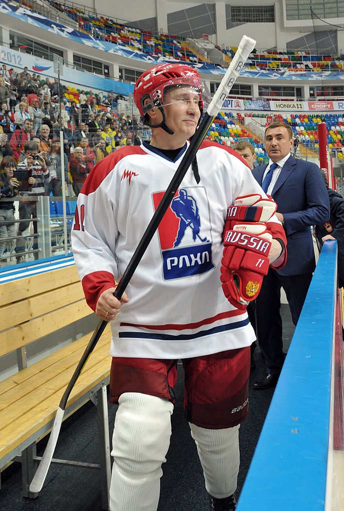 Russia's President Vladimir Putin (front) takes part in a game at the All-Russian ice hockey festival among amateur teams at Megasport Arena in Moscow, May 7, 2012. Putin played for Team of the Russian Amateur Ice Hockey League, which competed with the Russian Legends Team. (Photo credit: ALEXEI NIKOLSKY/AFP/GettyImages)