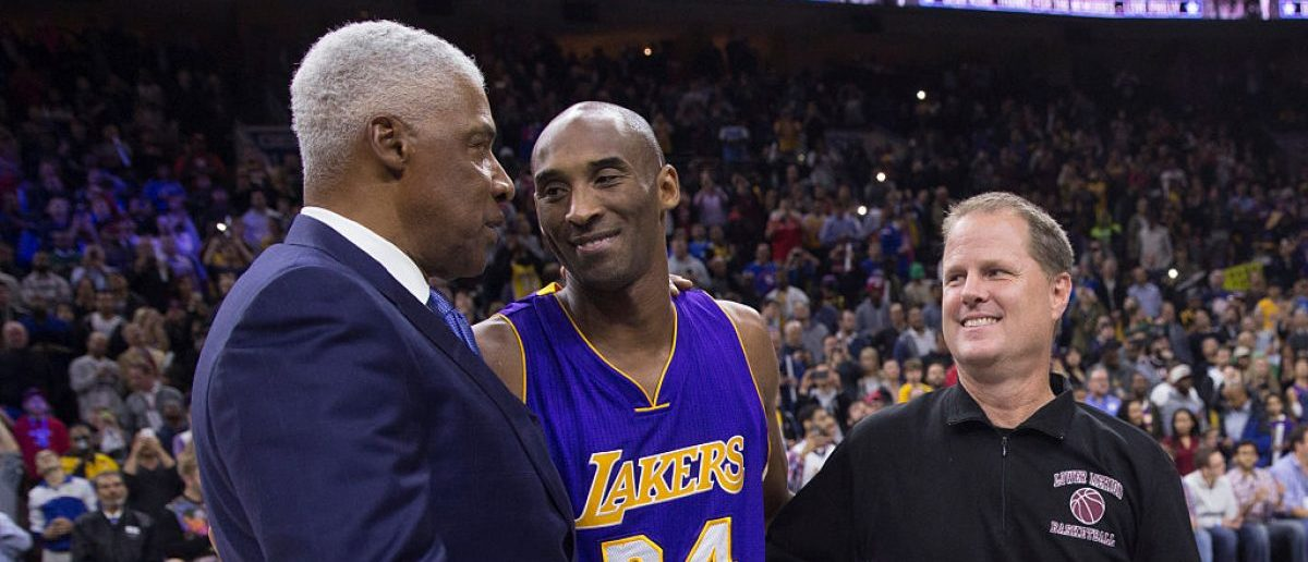 PHILADELPHIA, PA - DECEMBER 1: Former Philadelphia 76ers Julius Erving, Kobe Bryant #24 of the Los Angeles Lakers, and Bryant's Lower Merion High School basketball coach Gregg Downer share a moment prior to the game. (Photo by Mitchell Leff/Getty Images)