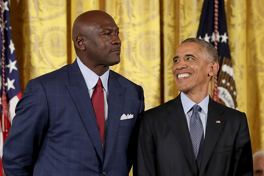 U.S. President Barack Obama smiles up at National Basketball Association Hall of Fame member and legendary athlete Michael Jordan before awarding him with the Presidential Medal of Freedom during a ceremony in the East Room of the White House November 22, 2016 in Washington, DC. Obama presented the medal to 19 living and two posthumous pioneers in science, sports, public service, human rights, politics and the arts. (Photo by Chip Somodevilla/Getty Images)