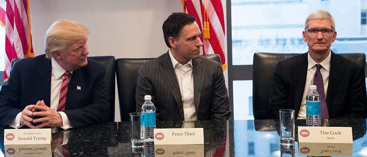NEW YORK, NY - DECEMBER 14: (L to R) President-elect Donald Trump, Peter Thiel and Tim Cook, chief executive officer of Apple, Inc., listen during a meeting with technology executives at Trump Tower. (Photo by Drew Angerer/Getty Images)