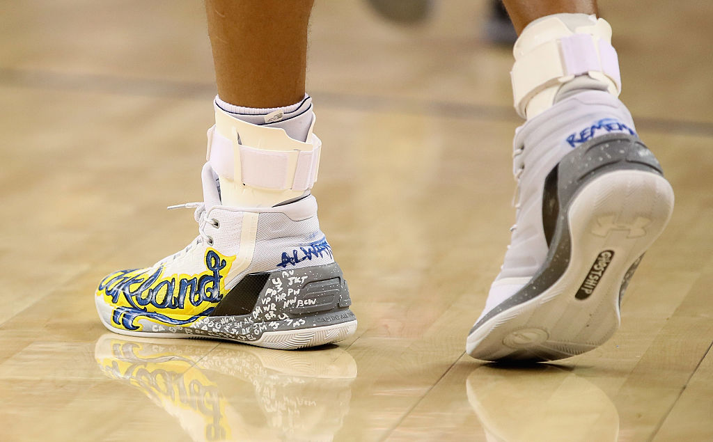 A close-up of the shoes that Stephen Curry #30 of the Golden State Warriors wore during their game against the New York Knicks at ORACLE Arena on December 15, 2016 in Oakland, California. The shoes are a tribute to all the lives that were lost in the Ghost Ship warehouse fire in Oakland on December 2. NOTE TO USER: User expressly acknowledges and agrees that, by downloading and or using this photograph, User is consenting to the terms and conditions of the Getty Images License Agreement. (Photo by Ezra Shaw/Getty Images)