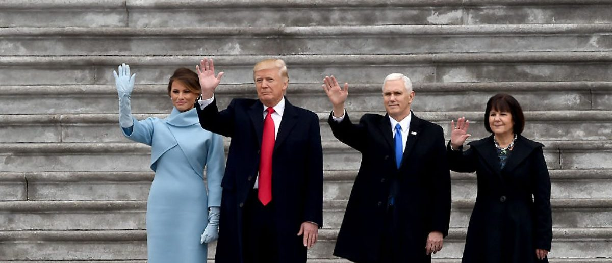 L-R: First Lady Melania Trump, US President Donald Trump, Vice President Mike Pence and his wife Karen, wave goodbye to former President Barack Obama's helicopter as it departs from the US Capitol after Trump's inauguration ceremonies at the US Capitol in Washington, DC, on January 20, 2017. (Photo credit: ROBYN BECK/AFP/Getty Images)