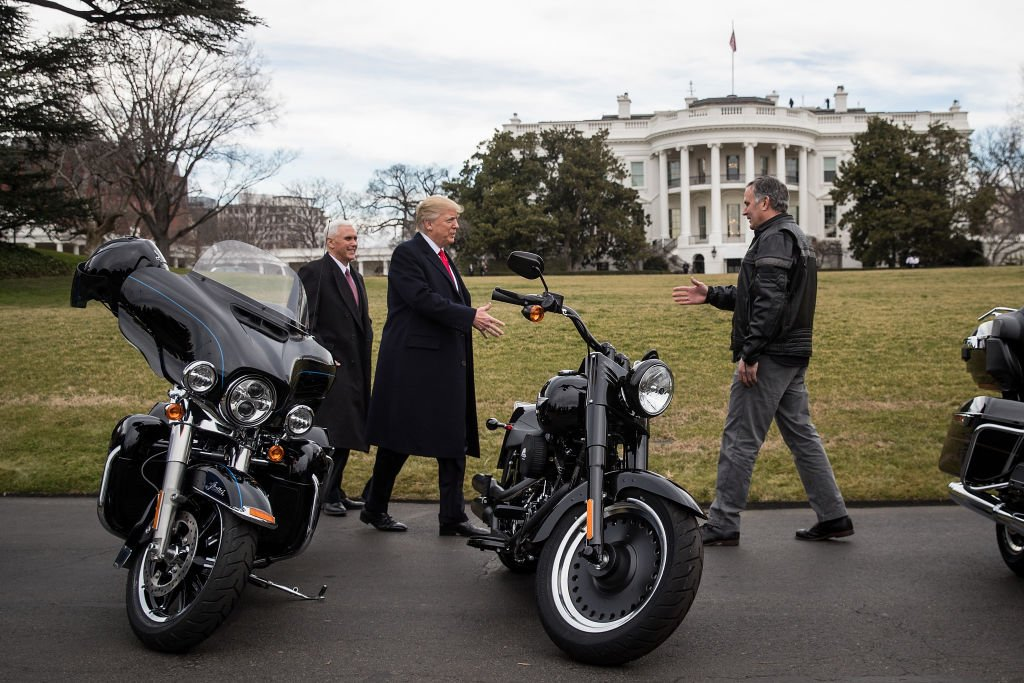 WASHINGTON, DC - FEBRUARY 2: (L to R) Vice President Mike Pence and President Donald Trump greet Harley Davidson Chief Executive Officer Matthew Levatich on the South Lawn of the White House, February 2, 2017 in Washington, DC. President Trump is meeting with Harley Davidson executives on Thursday afternoon. (Photo by Drew Angerer/Getty Images)