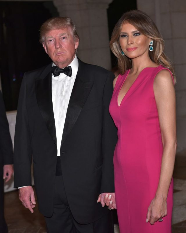 President Donald Trump and First Lady Melania Trump arrive for the 60th Annual Red Cross Gala at his Mar-a-Lago estate in Palm Beach on February 4, 2017. (Photo credit: MANDEL NGAN/AFP/Getty Images)