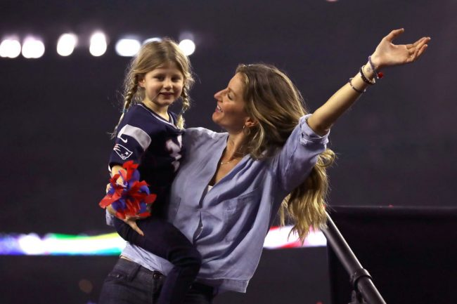 Gisele Bundchen celebrates with daughter Vivian Brady after the New England Patriots defeated the Atlanta Falcons during Super Bowl 51 at NRG Stadium on February 5, 2017 in Houston, Texas. The Patriots defeated the Falcons 34-28. (Photo by Ronald Martinez/Getty Images)