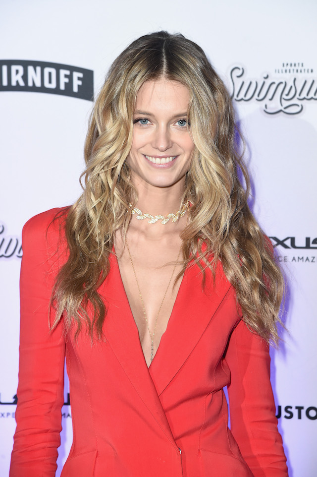 Kate Bock rocked her red suit. (Photo by Nicholas Hunt/Getty Images for Sports Illustrated)