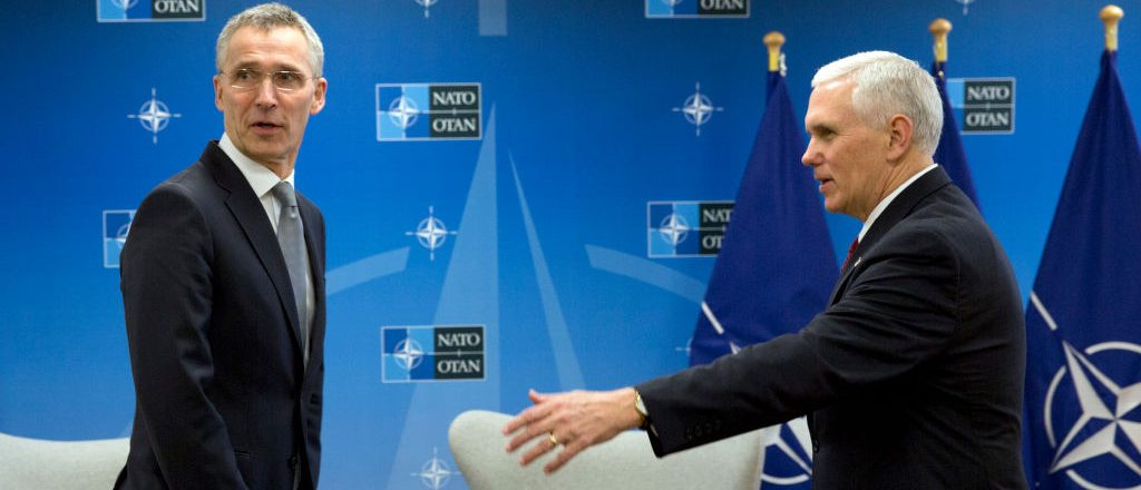 US Vice President Mike Pence (R) speaks with NATO Secretary General Jens Stoltenberg during a meeting at NATO headquarters in Brussels on February 20, 2017. Pence is currently on a one-day visit to meet with EU and NATO officials. VIRGINIA MAYO/AFP/Getty Images