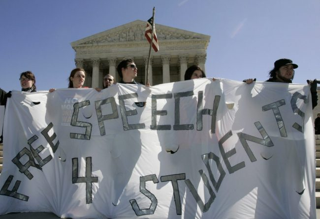 Students hold a free-speech rally outside the Supreme Court in Washington March 19, 2007. REUTERS/Molly Riley